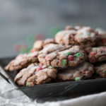Close up image of chocolate crackletop cookies on a silver platter