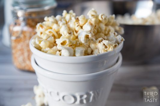 Honey Butter Popcorn // The kids will flip over this delicious popcorn recipe! You only need five ingredients - and I can almost guarantee you have everything on hand already. Plus, there's no microwave involved - say goodbye to yucky chemicals!   Tried and Tasty