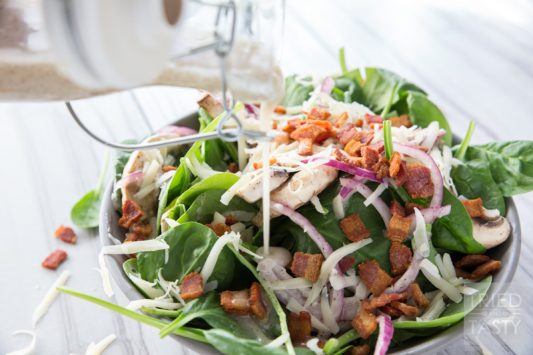 Spinach Salad // You wiill fall in love at first taste with this salad. A delicious combination of so many wonerful flavors. Great addition to any dinner table spread. Great for BBQ's, picnics, potlucks, or holiday parties. Simple to put together!   Tried and Tasty