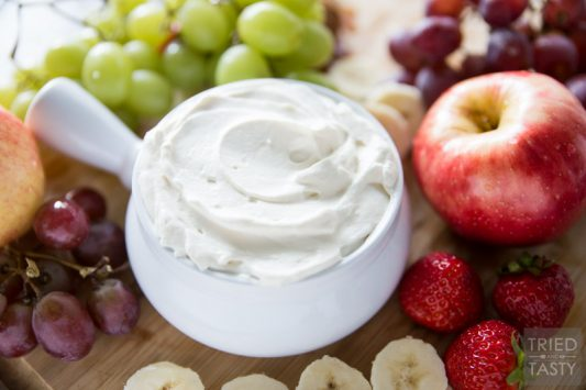 Honey Sweetened- Fruit Dip // Fruit is already sweet, so you don't need a sugar loaded dip to dunk it in. This fruit dip is absolutely perfect. It's light. It's fluffy. And it's *just* sweet enough, and sweetened all naturally with honey! Serve this at your next potluck or party and everyone will want the recipe!   Tried and Tasty