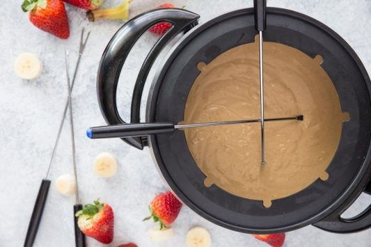 3-Ingredient White Chocolate Peanut Butter Fondue // Calling all fondue lovers! Tried of the traditional milk chocolate? Switch things up a bit with this fun new recipe that will surely tickle your tastebuds in the best way! Serve with your favorite fruit or dippers for a delicious sweet treat.   Tried and Tasty