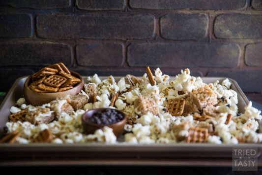 Crispy Pumpkin Spice Snack Mix | This amazing mix is infused with the flavors of Fall, including pumpkin and cinnamon. Say goodbye to plain old popcorn, and hello to the sweet and salty flavors of this delectable mix! | Tried and Tasty